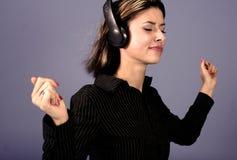 Femme et musique Photographie stock