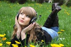 Femme et musique Photos stock