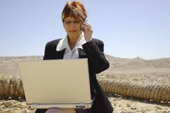 Femme et ordinateur portatif Photographie stock
