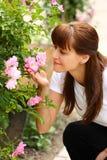 Femme et roses Photo stock