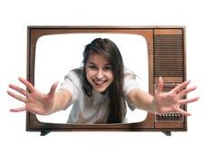 Femme et TV Photographie stock