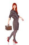 Femme exagérée avec la valise Photographie stock libre de droits
