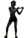 Femme exerçant la silhouette de formation de poids de séance d'entraînement de forme physique image stock