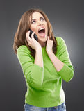 Femme fâchée avec le téléphone Images libres de droits
