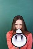 Femme fâchée avec un mégaphone Images stock
