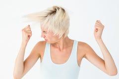 Femme fâchée secouant sa tête photographie stock