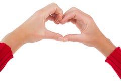 Femme faisant la forme de coeur avec des mains Photo stock