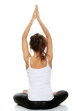 Femme faisant la pose de yoga Photo stock