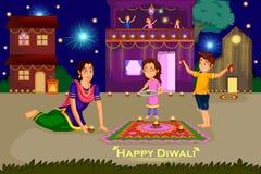 Femme faisant le rangoli pour le festival de célébration de Diwali de l'Inde Photos libres de droits