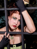 Femme Fatale Behind Bars Stock Photo