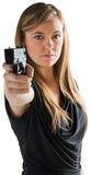 Femme-fatale, das Gewehr auf Kamera zeigt Lizenzfreies Stockbild