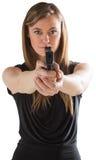 Femme-fatale, das Gewehr auf Kamera zeigt Stockbilder