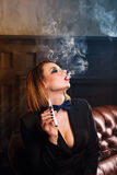 Femme fatale and electronic cigarette Stock Images