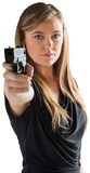 Femme fatale pointing gun at camera Royalty Free Stock Image