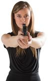 Femme fatale pointing gun at camera Stock Images