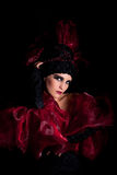 Femme fatale in a red-black dress Royalty Free Stock Photography