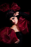 Femme fatale in a red-black dress Royalty Free Stock Photo