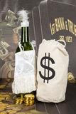 Femme Fatale. A wine bottle dressed as a flapper next to a money pouch Royalty Free Stock Photography