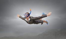 Femme flottant en ciel Media mélangé photo stock