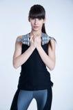 Femme forte avec une haltère Photographie stock