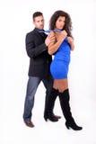 Femme frottant un homme avec sa relation étroite Photographie stock libre de droits