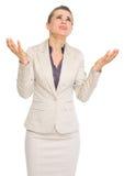 Femme frustrante d'affaires priant pour l'aide Photographie stock libre de droits