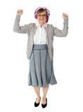 Femme âgé gai appréciant la musique Images libres de droits