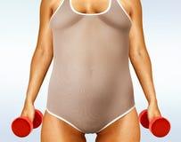 Femme grasse avec des haltères Photo stock