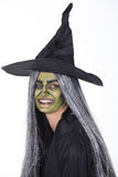 Femme habillée comme sorcière Photographie stock libre de droits