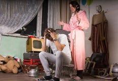 Femme harcelant son mari Photo stock