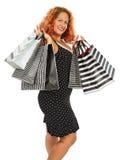 Femme heureuse avec beaucoup de paniers images stock