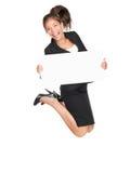 Femme heureuse branchante d'affaires retenant le signe blanc   Photographie stock