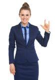 Femme heureuse d'affaires montrant l amour que vous faites des gestes Photo stock