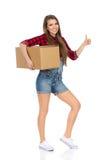 Femme heureuse et livraison Images stock