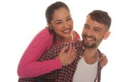 Femme heureuse montant sur le dos sur l'ami Image libre de droits
