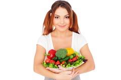 Femme heureux avec des légumes Images stock