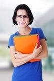 Femme heureux d'étudiant avec des cahiers Image stock