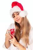 Femme heureux dans le chapeau de Noël Photographie stock libre de droits