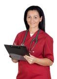 Femme heureux de docteur avec la planchette image libre de droits