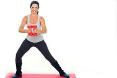 Femme heureux de forme physique avec la cloche sourde-muette Image stock