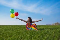 Femme heureux sur la zone Photographie stock