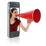 Femme hurlant dans le mégaphone Photo stock