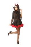 Femme intégrale de diable se tenant avec le genou plié Photo stock