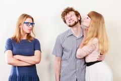 Femme jalouse avec les couples heureux Photographie stock