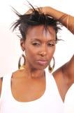 Femme jouant avec le cheveu Photographie stock libre de droits
