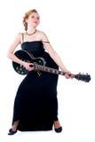 Femme jouant la guitare électrique Images libres de droits