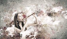 Femme jouant le fifre Photo libre de droits
