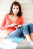Femme à la maison Photographie stock