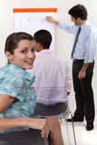 Femme lors de la réunion d'affaires Images stock