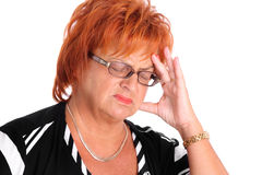 Femme mûr avec le mal de tête Image stock